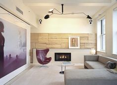 minimal living room - light color palette, love the paneling around the fireplace