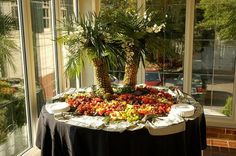 Dazzle your guests with this Pineapple Palm Tree Fruit Display.  The perfect buffet centerpiece for your wedding or luau party!  Get more information at www.chefmike.com/products.html