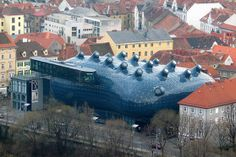 """Kunsthaus, Austria Called the """"Friendly Alien"""" by its creators, Peter Cook and Colin Fournier, the Kunsthaus Graz is an art museum in Graz, Austria built in 2003. The blob-like structure definitely deviates from the typical minimalist style of modern art museums and at night, when it's lit up, it looks unlike anything else in the world."""