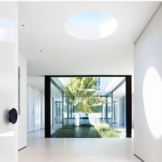 White interior, ceiling walls & floor black accents, green plants, light blue from skylights & open interior courtyard sky Art Photography /Canvas Paintings should be considered in limited amount Grand Designs Australia - Series Brighton Sixties Grand Designs Australia, Australian Architecture, Interior Architecture, Australian Homes, Patio Interior, Interior Design, Interior Decorating, Brighton Houses, Ideas