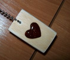 Self-made wooden pendants with resin heart. It is made of oak wood and resin of spruces from forest.