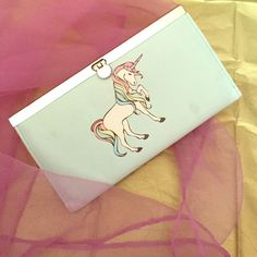 """Unicorn wallet clutch Dimensions are 7.5"""" wide 4.5"""" tall and has coin zipper pouch inside. Can fit up to 10 cards easily. Please note the scuffs and dings. If it is listed here then it is still available so don't worry asking. Also, don't ask me to make a deal, just submit an offer and we will go from there. Happy poshing! Hot Topic Bags Clutches & Wristlets"""