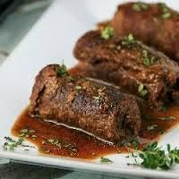 Rouladen are German meat rollups with onions, mustard, bacon, and pickles, all wrapped up in thin beef slices and then cooked. This dish . Rouladen Recipe, Beef Rouladen, German Rouladen, German Bratwurst, Beef Braciole, German Meat, Beef Roll Ups, Meat Recipes, Cooking Recipes