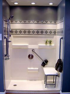 Renovated shower to allow access to all. Grab bars located on the sides and back wall, and a seat located in the back.