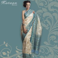 Fawn Color Net Saree With Ferozi Border And Pallu