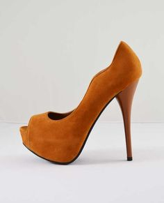 """Sleek velvet peep toe in a beautiful rust color enhanced with a little curve at the instep and tonal stitching.  Shiny stiletto heel. Run true to size.  Platform: 1.25""""  Heel height: 5""""  All Man Made Material.   Imported.   $38.00"""