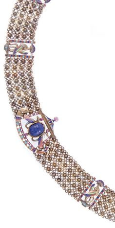 An Egyptian Revival gold, enamel, lapis lazuli, ruby and diamond necklace, circa 1900. #EgyptianRevival #antique