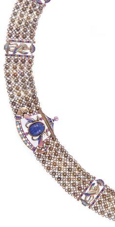 An Egyptian Revival gold, enamel, lapis lazuli, ruby and diamond necklace, circa 1900. #EgyptianRevival #antique