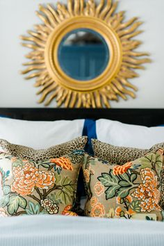 Our home tour: master bedroom (gold sunburst mirror, blue and white bedding, leopard pillows, Chiang Mai dragon fabric)