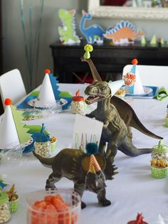 Fiesta Friday - Jurassic World Birthday Party Ideas Adorable dinosaur party: mini party hats on dinosaurs, spikes on party hats, dinosaur food (bugles as dino claws, chocolate rocks, jelly beans(?) as dinosaur eggs). Dinosaur Birthday Party, 6th Birthday Parties, Third Birthday, Boy Birthday, Birthday Ideas, Elmo Party, Birthday Table, Mickey Party, Themed Parties