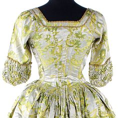 """Detail back view of brocade of bright yellow, green and ivory silk satin open robe, ca. 1740s, England. Provenance: 'Lady Frances Clemant's Wedding Dress"""". Bonhams"""