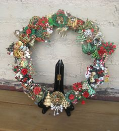 wreath made out of vintage christmas pins.