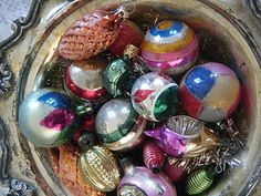 vintage ornaments in a silver bowl
