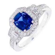 Cornflower Blue Sapphire And Diamond Halo  Platinum Engagement Ring | From a unique collection of vintage engagement rings at https://www.1stdibs.com/jewelry/rings/engagement-rings/