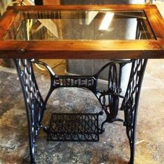 Repurposed singer sewing machine base I made into a table by brookeO