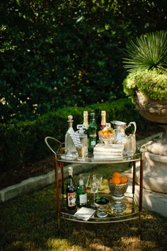Love the Vintage Cocktail Cart in front of Lovely Urn planting