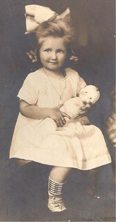 Mother and her Kewpie doll 1916