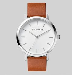 A simple take on the classic time-teller. Featuring a polished stainless steel case, white face with minimalist markers and tan leather band. The Horse logo lettering on dial and at buckle closure. Overtime the strap will develop an inherent, natural patina that improves with age. This leather will inherently pick up marks and stains and darken with everyday wear.