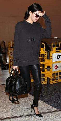 Keeping her head down: Kendall Jenner was trying to keep a low profile as she jetted out o...