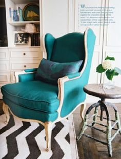 Chevron rug plus teal chair plus rustic accent table equals love.