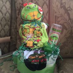 Teenage mutant ninja turtles diaper cake TY ball turtle Turtle onesie and short set Turtle bottle  Turtle socks  Pacifier  Diapers Will b wrap in plastic with bow Other