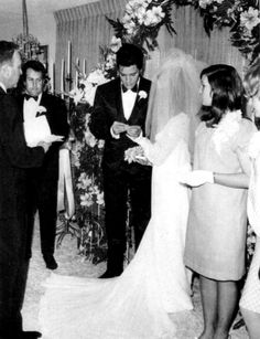 Elvis trying to get the ring steady to place on Cilla's finger..sweet photo.