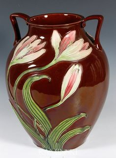 "Julius Dressler, Austria, Art Nouveau ceramic vase, majolica glazed tube-lined lily design, 12 1/2""h x 9 1/2""w."