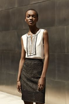 Try Ann Taylor's embroidered tank and black lace pencil skirt together for a richly detailed, polished look.