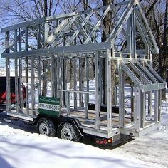 Naked Cabins from Tiny Green Cabins in MN. You get the frame and trailer to finish building!