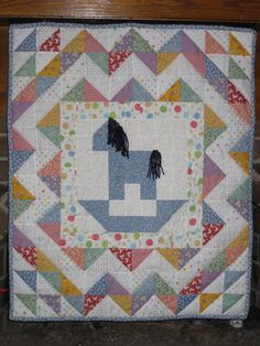 Rocking horse quilt with reproduction fabrics