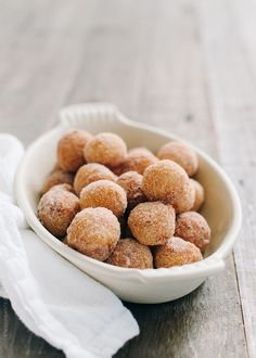Churro Doughnut Holes with Ice Cream and Cherry Chipotle Sauce | www.kitchenconfidante.com | Is there anything better than fresh churro doughnut holes? Actually yes. Add some ice cream and a warm cherry chipotle sauce!