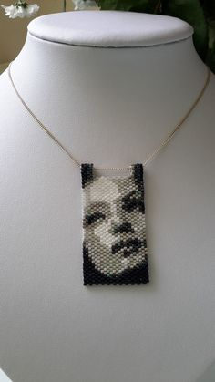 A beautiful peyote stitched beaded mini tapestry, depicting a woman. Made using Miyuki Delica beads. This is lovely for day wear or evening wear, you will get noticed in this necklace! Includes an 18 inch silver chain, this can be changed if you would prefer on a cord or a 16 inch chain.