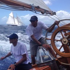 Capt. Nathaniel Wilson at the helm of the mighty L.F. Herreshoff ketch TICONDEROGA with Fife schooner ADVENTURESS in the background, 2014, Antigua. Photo courtesy of Nat Wilson ~ www.woodenboat.com via FB https://www.facebook.com/WoodenBoatPub/photos/a.10150140487995603.396179.10150140252985603/10155797028845603/