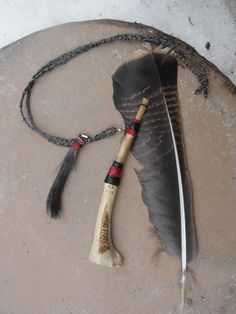"""etched tail feather motif with a """"Jake"""" beard lanyard :{)"""
