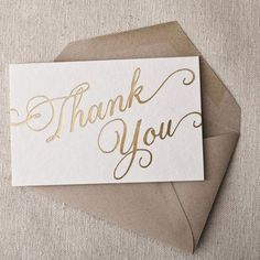 """Say a bold """"thank you"""" in elegant gold cursive script. ______________________________________________ Made in Syracuse, NY by Smock. Box of 6 folded cards and envelopes, each 3.31"""" x 5.44"""". Sustainabl"""