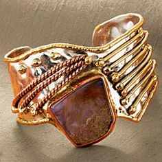 """Tri-Metal Bracelet    Adorn yourself in style with our silver-tone, brass and copper bracelet with natural agate. Extraordinarily handcrafted with an easy on-off cuff style. 1½""""w. Variations in the natural stone will occur."""