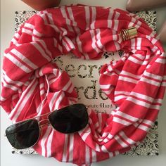 J crew cotton jersey scarf Really soft and bright scarf that's great for spring. A long rectangle with a casual vibe. Bright coral with white stripes and unfinished edges. It was maybe worn once. Needs a good home J. Crew Accessories Scarves & Wraps