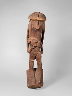 House Post Figure    Date:      19th century  Geography:      Indonesia, Papua Province (Irian Jaya), Kabiterau village, Lake Sentani  Culture:      Sentani people  Medium:      Wood  Dimensions:      H. 36 1/8 x W. 8 1/2 x D. 8 1/2 in. (91.8 x 21.6 x 21.6 cm)  Classification:      Wood-Sculpture