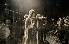 Keith Richards trying to calm down audience just before Altamont riots; Hell's Angels in front of them