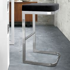 """Glam yet functional, the Mack Bar Stool is designed as a sleek study of contrasts observes Kravitz Design: It has a lightness, but doesn't look delicate...it's sophisticated, but comfortable...it's sexy, but very utilitarian."""""""