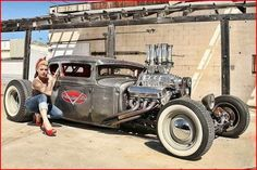 Wow! Nice hot rod and pin up.