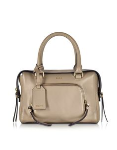 Greenwich Leather Small Satchel Bag crafted in natural calfskin, has an air of sophistication that transitions from on-duty to off-duty. Featuring top zip closure, double handles, adjustable and detachable shoulder strap, internal zip pocket, external front zip pocket, logo tag and gold tone hardware.