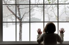 Charming and quiet image of child with hands pressed against window pane in winter with bare trees and snow. Beautiful winter and holiday decor inspiration. Winter Schnee, Winter Love, Cozy Winter, Winter Colors, Winter Magic, First Snow, Window View, Winter Christmas, Christmas Time