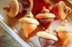 Acorns...made with Hershey kisses, vanilla wafers, and a peanut butter, or chocolate chip. Use a little bit of frosting to attach the kiss and the chip.  This is just one way to create the look of an acorn!  So cute.