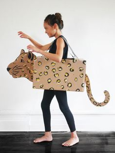CARDBOARD AMUR LEOPARD COSTUME by La maison de Loulou Today we are celebrating HALLOWEEN and trust me, it is an event no one in my family wants to miss! Best part are the costumes, and Trick or Treats! Every year we are getting creative, and our 2018 … Cardboard Costume, Cardboard Crafts, Cardboard Play, Cardboard Animals, Yarn Crafts, Diy Crafts, Diy For Kids, Crafts For Kids, Amur Leopard