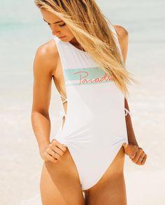 L Space - Laura Sleeveless open sides one-piece bodysuit with paradise print on front. Lace up on sides that string ties. High leg. Keyhole cut out on back. Classic coverage. #newarrivals #mermaid #mermaidlife #beach #beachday #beachlife #beachstyle #bikinis #bikinigirl #bikinibabe #summer #summerstyle #summervibes #honeymoon #onlineshopping #shoponline #traveler #wanderlust