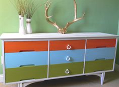 Awesome multi colored dresser on a budget! Colorful Dresser, Colorful Furniture, Cool Furniture, Painted Furniture, Furniture Ideas, Cabinet Furniture, Furniture Makeover, Dresser Storage, Mid Century Dresser