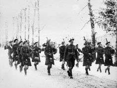 Pipers of the 2nd Battalion, Gordon Highlanders (20th Brigade, 7th Division) marching along a road. 1917