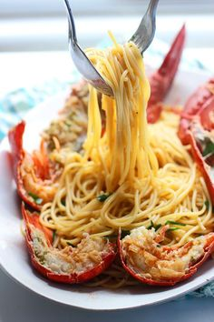 Lobster Spaghetti (Santorini Style) Lobsters are steamed, and bathed in a sauce of butter garlic and vermouth, then tossed with al dente spaghetti for a seriously decadent seafood extravaganza.