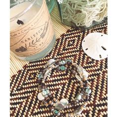 Our @631carleton soy candle alongside this beautiful handmade piece by @creationsbysamantha_ Thanks for including us in your pic! #local #locallove #handmade #creationsbysamantha #hamptonshandpoured #carleton #631carleton #lilove #longislandlove #longisland #li #beachlife #ocean #salt #citrus #hydrangea #jewelry #bracelet by hamptonshandpoured